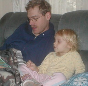 Donald reading to Rhi, small