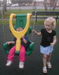 Rhi pushing Cor on swing